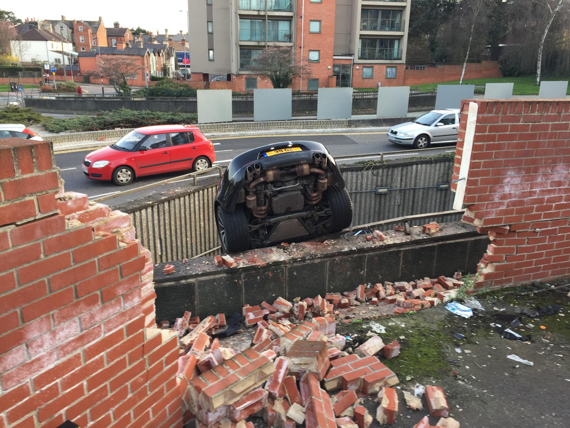 Pensioner crashes £92000 Porsche through wall and onto underpass